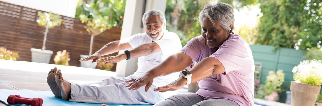 enior couple doing stretching exercise