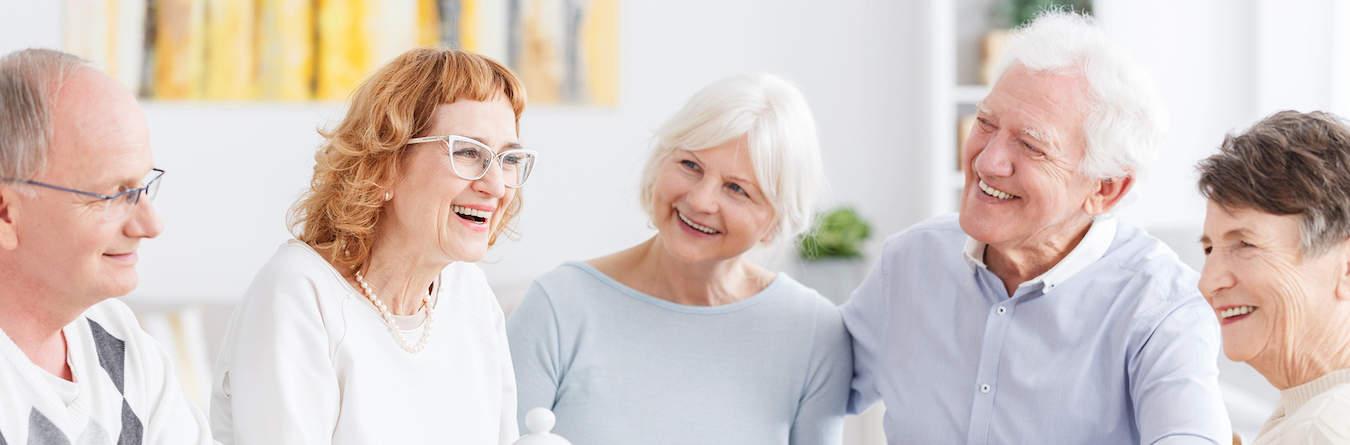 Group of happy older people on a meeting in senior club