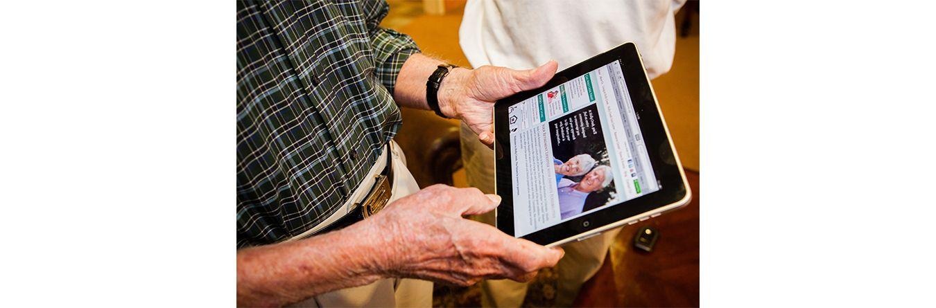 Elderly man using tablet for information