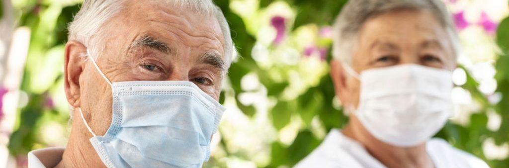 Seniors wearing masks together