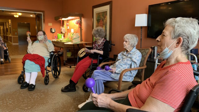 Seniors participating in music therapy session